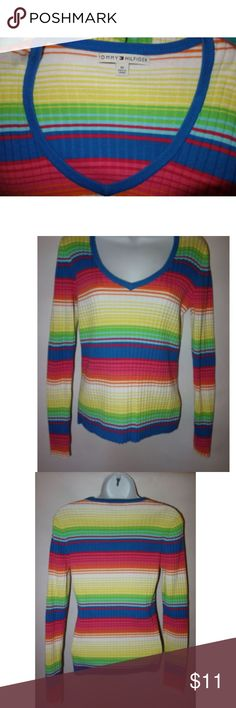 """Tommy Hilfiger Knit Top Rainbow Stripe V M Tommy Hilfiger Women M Rainbow Stripe Knit Top V Neck Ribbed Vintage B12 Preowned in great condition Multi colored rainbow stripe V neck Long sleeve Rib Knit No rips, tears or stains Length from shoulder to hem is 23.5"""" Chest from under arm to under arm is 17"""" I have other items like this listed Thank you for looking! Tommy Hilfiger Tops"""