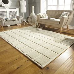 This beautifully textured geometric wool rug adds a stunning simplicity to your room. Hand carved, bevelled and finely finished resulting in a super heavy rich wool pile of exceptional quality. Available in 3 different sizes.