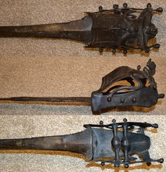 Indian hooded katar, 18th century, a very old and long version of the katar. A development stage between the pata (long gauntlet sword) and the short katar push dagger. long and narrow rapier type blade, 38 inches. The cross bars are shaped like small balls. The handle is protected with a steel hood terminating in a styled yali (monster head) shaped tip. 44 inches total length. Detail view of the handle.