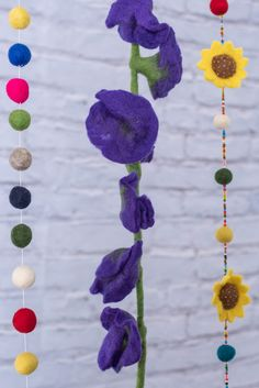 """Bring vibrant color and fanciful flower power to your bohemian decor with this multicolor felt flower garland! The fab softness of felt also makes this unique decor accent a fun hat-topper or playful costume accent.Measurements60"""" long Rose Garland, Flower Garlands, Flower Fairies, Nuno Felting, Cool Hats, Recycled Crafts, Felt Flowers, Bohemian Decor, Wind Chimes"""