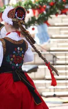 #The back side glimpse of a beautifully embroidered traditional Polish folk costume.  I would wear one of these during parades. it's called a......I can say it in polish but don't know how to spell it. It sounds like this    cra..ko ..von..ki. Remember to roll those RRRRRRs