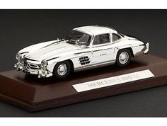 This Mercedes-Benz 300 SL (1954) Diecast Model Car is Chrome Effect and features working wheels. It is made by Ex Mag and is 1:43 scale (approx. 9cm / 3.5in long). This model comes on a real wood base with name plaque....