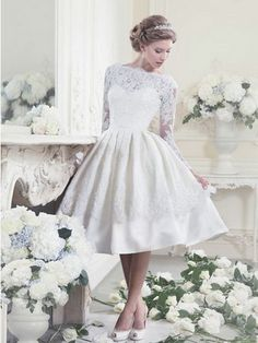 short lace wedding dress with sleeves I love it but not as a wedding dress .. In black or a cobalt blue for a bridesmaids dress
