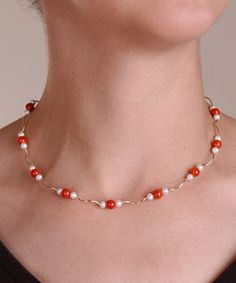 Necklaces  @Overstock - Add a splash of color to your outfits with a lovely pearl/coral necklace  Jewelry features curved links of 14-karat yellow gold with 12 stations of coral  Pretty necklace secures with a lobster clasphttp://www.overstock.com/Jewelry-Watches/DaVonna-14k-Gold-White-Cultured-Pearl-and-Coral-18-inch-Necklace-4-4.5-mm/61817/product.html?CID=214117 $149.99