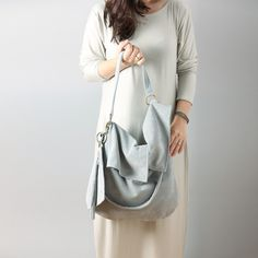 Perfect gift for every woman: mother, sister, best friend or just for you! This slouchy hobo made of soft and beautiful, finest italian suede leather in very elegant shade od light grey. Buttery soft leather, very lightweight. It is big, simple and asymmetric – a unique product by RARAMODO via en.DaWanda.com