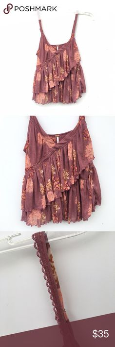NWOT Free People Floral Layered Tank Purple-pink Free People top with a pink floral design. Layered top, with scrunch like trimming. Straps have extra designs as well. New without tags and unworn. Free People Tops Tank Tops