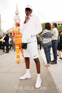 Men's Street Style | Sporty White - Bag yourself a comfortable pair of sporty shorts along with a sporty jacket, and fresh white trainers. Drop this with a cap and your socks pulled up. | Shop the look at The Idle Man
