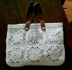 A bright, soft, maxi-tote-bag featuring traditional granny squares in a very stylish design.