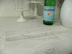 How Corian Rain Cloud (countertop) compares to real marble (sample laying on top)