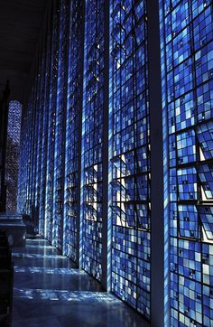 It will never happen but wouldn't it be cool to have a stained glass wall like this in a home? I'd probably choose a cheerier color than dark blue tho. :)