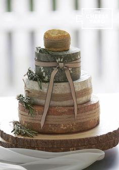 Rustic charm from Chloe with  nutty caramelly red Leicester, buttery blue, crumbly yarg, creamy langres.  Ideal for 70 - 90 guests Chloe - Wedding Cheese Tower by The Cheese Yard, Knutsford. Delivery throughout the UK and overseas.