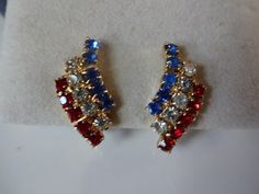 Vintage Red White and Blue Rhinestone Clip Earrings.  Sparkly pair of curved patriotic prong set rhinestone clip earrings, perfect for any occasion especially 4th of July, or Memorial Day! These are s
