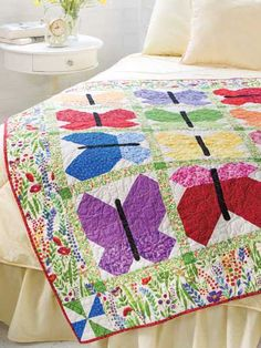 Beautiful Butterflies Quilt Pattern Download from e-PatternsCentral.com -- his is the perfect design for using pretty summer colors.