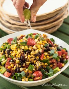 Grilled Corn Salad with Black Beans, Tomatoes & Bell Pepper.  Would add fresh roasted green chiles
