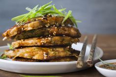 These Korean-inspired kimchi and pork pancakes are made with a buttermilk batter. For a more traditional pancake, replace the buttermilk with water.