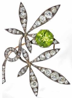 Rene Lalique Leaves and Fruit Brooch: 18K gold, silver, brilliant-cut diamonds, a single pearl & peridot, leaves & single piece of fruit, c.1892