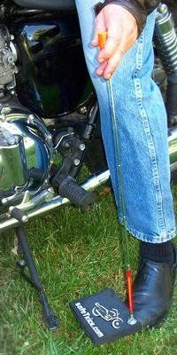 Finally ! A motorcycle kickstand pad with an easy to use pick up and placement collapsible handle $19.95