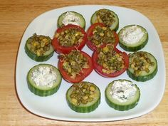 This is a mildly spiced, refreshing and healthy appetizer. Tomatoes and cucumbers are filled with sprouted moong or flavored cream cheese. It makes an amazingly colorful finger food that is easy to prepare and tastes incredible.