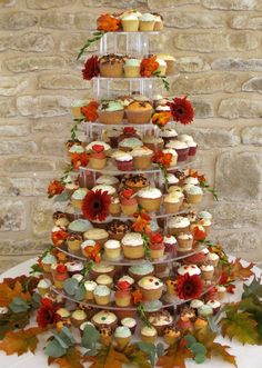 I like the 'messy' look that this one has... various sizes, colours and flavours, with the flowers giving a bit of a different texture. This would be a good idea if there were a few people involved, since the variety of cakes wouldn't matter...