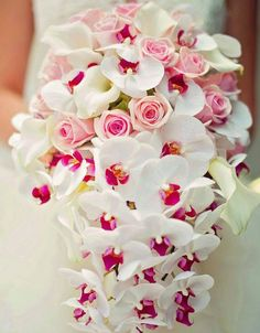 white rose and orchid wedding bouquet