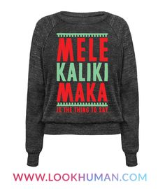 """Say """"Merry Christmas"""" the Hawaiian way with this island inspired Christmas shirt. This holiday shirt features the phrase """"Mele Kalikimaka, is the thing to say,"""" in a green and red font."""