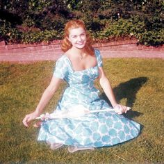 Esther Williams wearing a blue and white floral print dress, circa 1950.