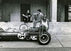 The rear wheel of Giancarlo Baghetti's Lotus 49 being used as an impromptu seat in the pits, Monza 1967. He lasted until Lap 50 when his engine let go.