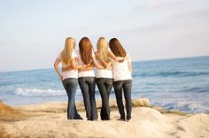 four friends at the beach -- totally going to do this when they come up here!