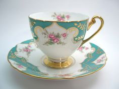 Rare SHELLEY Tea Cup And Saucer, Teal, White and Gold with pink Rosebuds teacup and saucer. by AntiqueAndCrafts on Etsy