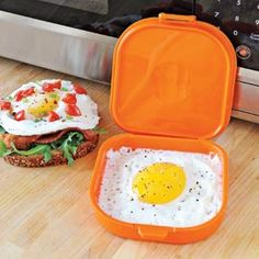 I so want this! Microegg, Silicone Egg Sandwich Microwave Pan | Just crack an egg into this silicone mold that's the same size as a piece of sandwich bread. Scrambled or sunny side up, it's ready for a sandwich after about 60 seconds in the microwave. Add salt and pepper...even cheese. Enjoy without the bread, too. High temperature, nonstick silicone is dishwasher safe.