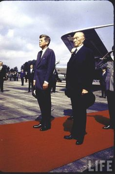 http://en.wikipedia.org/wiki/John_F._Kennedy     (L-R) Pres. John Kennedy & Chancellor Konrad Adenauer treading red carpet during airport arrival ceremony in West Germany - Kennedy is about to give his famous Ich Bin Ein Berliner speech later on during the visit. (June 1963)