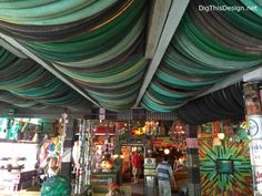 Satchel's eclectic decor, repurposed bicycle tires and garden hoses for ceiling decor.