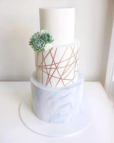 rich blue sea glass candy adorns modern ocean theme wedding cake