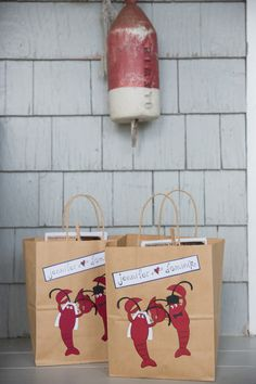 WELCOME BAGS: Have guests coming to your wedding from out of town? Welcome them with a lovely gift bag featuring Maine's most famous crustacean! Photo: Kivalo Photography
