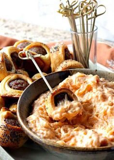 Easy Oktoberfest Crescent Wrapped Bratwurst Bites with Sauerkraut Dipping Sauce are just the thing to serve during a Fall party or gathering. They're also super simple to make, and everybody loves them! Make some today! - Kudos Kitchen by Renee