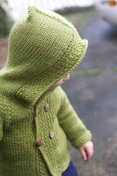 Green hooded sweater.