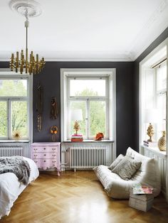 Dark grey/blue walls. I like the blonde unique floors with this wall color