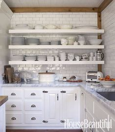 Inspiration for unit 2 - reclaimed lumber trim with white tile, white cabinets, open shelving