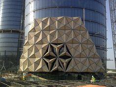 Façade Engineering Blog -Al Bahar Towers based on traditional Arabic Mashrabiya shades,  variable, geometric, modular, could be solar panels