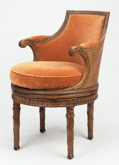 Chair (fauteuil de toilette) -- Georges Jacob (French, 1739 - 1814, master 1765), and Jean-Baptiste-Simon Rode (French, 1735 - 1799, master 1766), and originally painted by Chaillot, et al -- Paris, France; about 1787 -- Carved beech; caning; modern silk velvet upholstery -- 85.1 x 57.8 x 54.6 cm (33 1/2 x 22 3/4 x 21 1/2 in.)