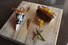 Abita Brewing Company Beer Pairing Dinner at Stadium. House Made Hot Dog with Cocoa Nibs, Fried Pretzel Bun, Chowchow, Malt Pickled Peppers, Black Beer Mustard Seed served with Parsnip Chips. #LBR
