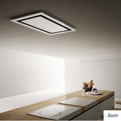 How amazing is this ceiling mounted exhaust fan for a cooktop. I opened my wall up from my condo entrance and this would be the perfect solution so that I don't obscure the view to the water. I want this!  It is by an Italian manufacturer ELICA. They don't make their line for the USA.