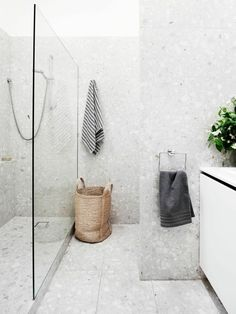 Modern Renovation Of A Melbourne Townhouse In the bathroom, the existing shower cubicle was converted into a laundry area and a new walk-in shower installed. In keeping with the home's sensibilities, terrazzo tiles were laid from floor to ceiling. Bathroom Floor Tiles, Shower Floor, Walk In Shower, Room Tiles, Shower Base, Shower Walls, Bathroom Towels, Shower Grout, Mosaic Bathroom