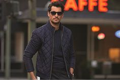 Who needs Christian Grey? David Gandy smolders as he kicks back overlooking the city in new M&S