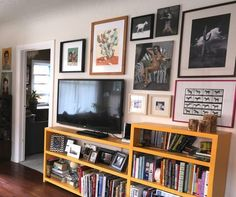 Televisions in Small Spaces ( This is another idea for our entertainment space...simple and clean with our movies, nicknacks, my books and of course the gallery wall)