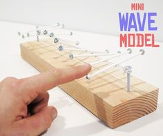 A little wave goes a long way! The mini wave model is small but mighty. With just a few minutes of set-up, it's just as good at demonstrating as its bigger siblings. This is a great model for waves that move, reflect, stand, and wiggle, perfect for a starter project in classrooms learning about waves and motion. What: Mini Wave ModelConcepts: waves, propagation, physicsTime: ~15 minutes to set upCost: ~$1.50Materials:Bolts x 2 (with nuts that fit)Nuts x 40 (or so)Sticks (I used candy…