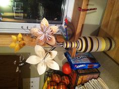 Wine bottle wrapped in yarn, + oragami flowers made from scrap book paper;)
