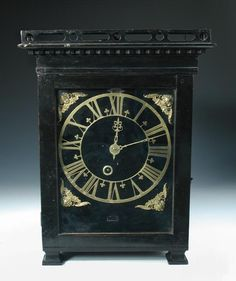 Sale F090316 Lot 690  'Johannes Tegelbergh Fecit Hagae', a late 17th century and later 'Haagse' clock, the verge movement with signed decorated backplate, silk suspended pendulum, pierced countwheel, striking on a bell at the top of the case above the skeletonised gilt chapter ring, date aperture above, on a hinged velvet covered dial and winged mask spandrels, on shaped feet , 43.5cm (17 in) high  - Cheffins