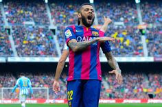 Dani Alves of FC Barcelona reacts during the La Liga match between FC Barcelona and Malaga CF at Camp Nou on February 21, 2015 in Barcelona, Catalonia.