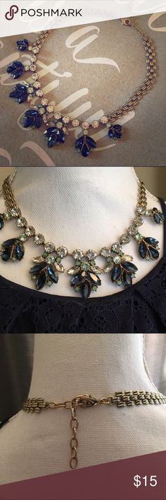 Statement necklace Gold statement necklace with deep blue, green and clear gems. Color of necklace is gold. Hook closure. So pretty and picks up every blue tone! Jewelry Necklaces